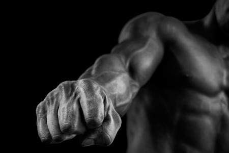 Closeup of a man39s fist. Strong and power man39s hand with muscles and veins. Studio shooting. 스톡 콘텐츠