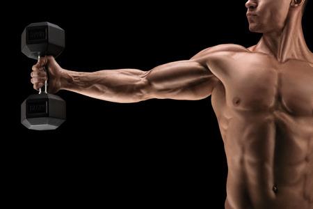 musculos: Primer plano de culturista fuerte con el paquete de seis, abdominales perfectos, hombros, bíceps, tríceps y el pecho, deltoides músculo. Foto de archivo
