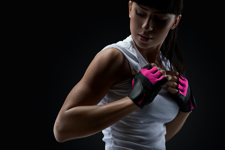 sports clothing: Ð¡lose up portrait of fitness athletic young woman in sports clothing showing her well trained body