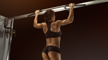 Professional Pull Up Workout Exercise Back Lats Muscles Pullups Pull torso up until the bar touches upper chest by drawing the shoulders and upper arms down and back.