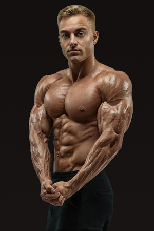 Shot of healthy power shirtless young athletic man with strong abs and core muscles. Perfect fit, six pack, abs, abdominal muscle, shoulders, deltoids, biceps, chest. Bodybuilder with muscular physique looking at camera showing both hands muscles. Vector  Standard-Bild