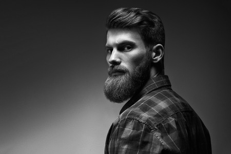 Black and white photo of bearded stylish businessman Handsome confident perfect hairstyle man indoor . Foto de archivo - 100188262