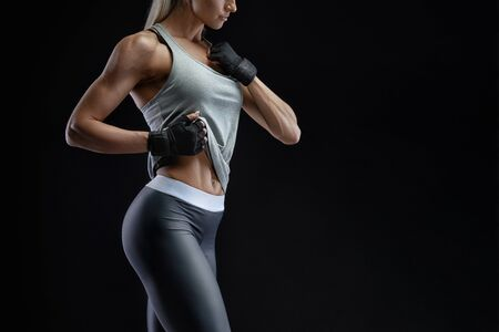 Croped image of sideview beautiful fit girl. Energy fitness motivation, workout, sport, lifestyle concept. Copy space. Workout bodybuilding concept. Fitness exercise.
