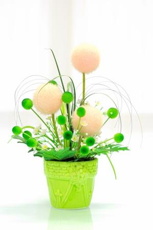 artificial flowers: Artificial flower in vase on mirror desk