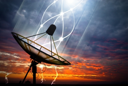 satellite tv: Black satellite transfer data under storm clouds