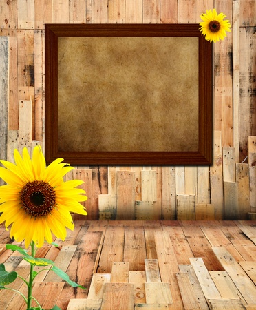 Papyrus paper in wood frame and sunflower photo