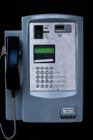 phonebooth: Close up of a Payphone on a black background