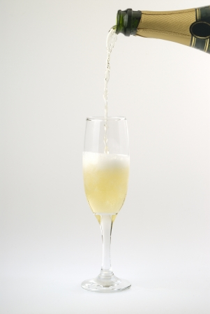 cava: Pouring cava on a cup