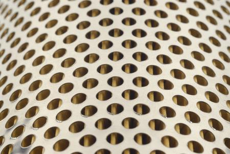 full of holes: full frame of holes in metal