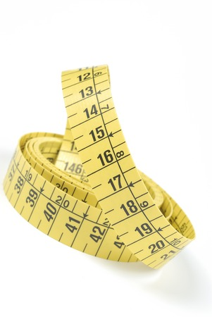15 18: Yellow measuring tape on white background