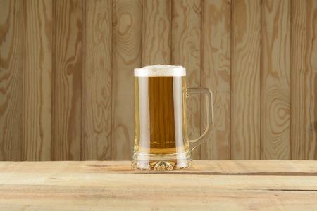 tankard: Tankard beer on wood background
