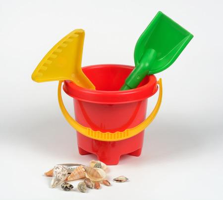 rake: Cube beach rake and shovel. Beach Toys. Stock Photo