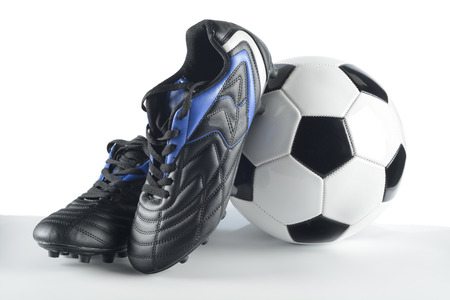 Football boots and ball Фото со стока