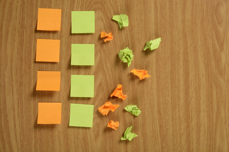 Crumpled and normal paper notes with a smooth, color orange and green Stock Photo