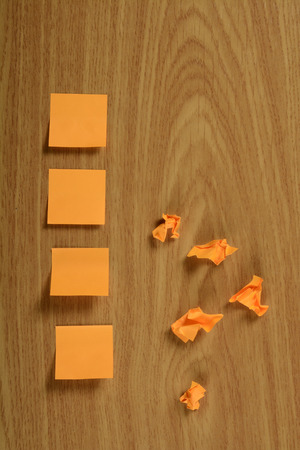 posit: Crumpled paper notes with a smooth, color orange