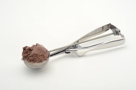 calory: Spoon to make balls of ice cream with chocolate ice cream Stock Photo