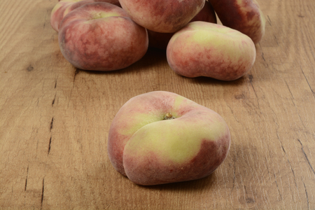 plano: Some donut peaches on brown background Stock Photo