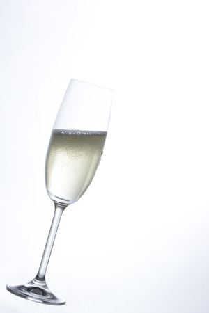 cava: Champagne in a glass, in a isolated white background