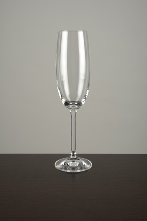 cava: Empty cup of glass for champagne on brown and gray background