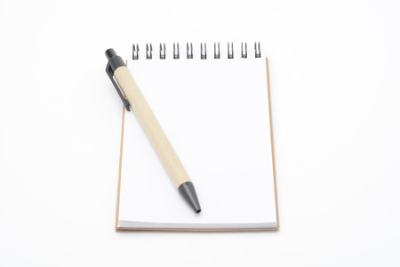 annotation: A empty notebook and one pen on white background Stock Photo