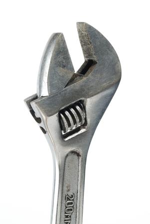 metal fastener: Detail of an adjustable spanner on white background
