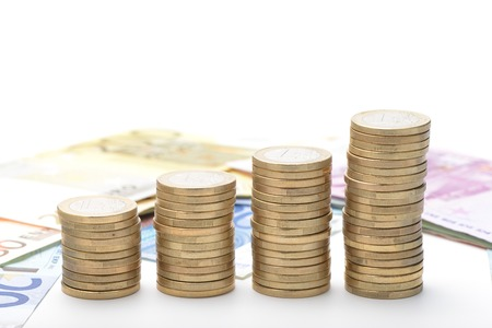 scaling: Euro coins stacked