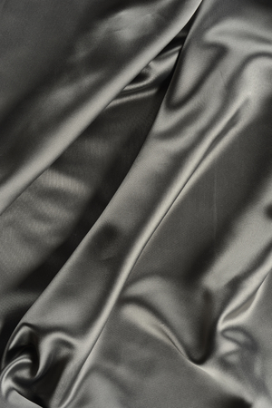 volumes: Effects of light in one gray satin fabric