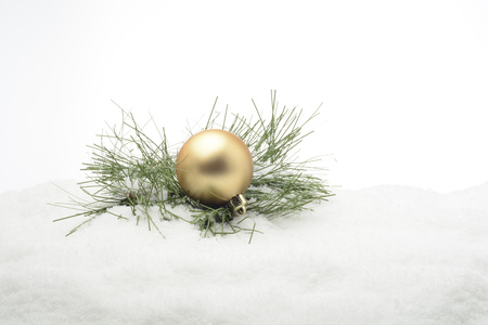 christmas ornamentation: Golden decorative ball over the snow