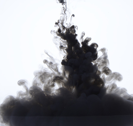 dissolve: Black ink petering out in water, white background