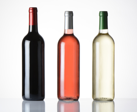 wine  pink: Bottles of red wine, pink and white on white background