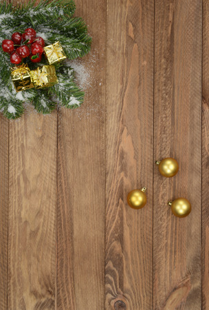 christmas ornamentation: Christmas postcard with brown wooden background