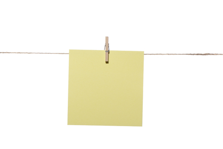 One note or posit hanging wooden pegs Stock Photo
