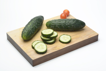 cortado: Sliced cucumbers in a kitchen table