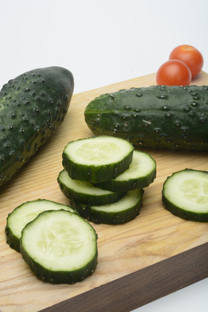 cortado: Sliced ??cucumbers in a kitchen table