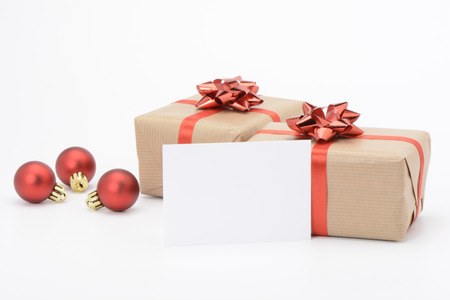 christmas ornamentation: Gift boxes with red ribbon on white background