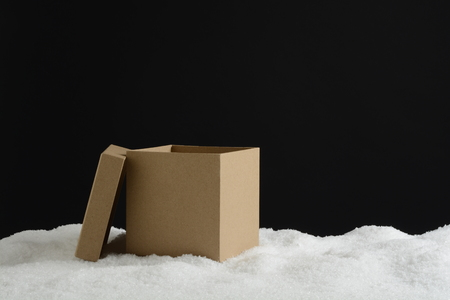 Open gift box in snow, card composition for background Stock Photo