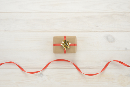 christmas ornamentation: Gift box on wooden white background, view from above Stock Photo