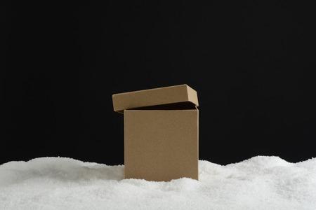 christmas ornamentation: Open gift box in snow, card composition for background Stock Photo