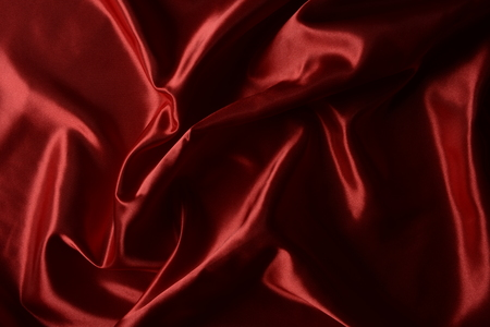 Effects of light in one red satin fabric, abstract composition Stock Photo