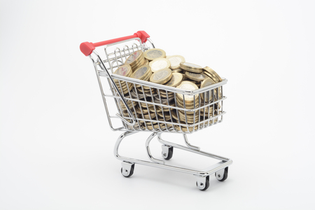 Shopping cart and euro coins Stock Photo