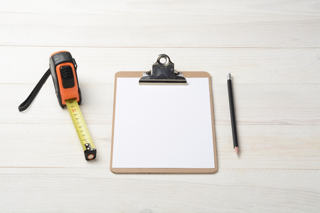 Folder, pencil and meter on white wood background Stock Photo
