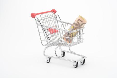 Shopping cart and Euro banknotes