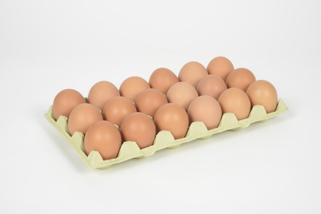 Eighteen eggs in a carton on a white background