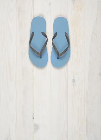 flip flops: Flipflops on a white wooden background, blue color on white