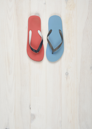 flip flops: Flipflops on a white wooden background, red and blue Stock Photo