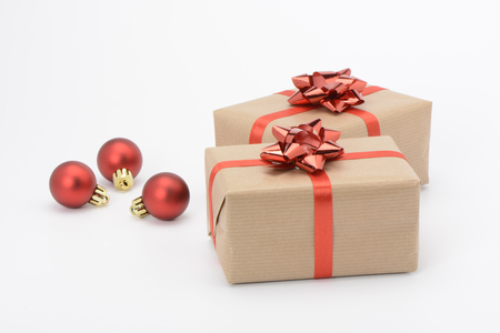 Gift boxes with red ribbon on white background