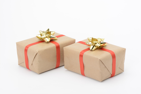 Gift boxes with yellow ribbon and red ribbon on white background
