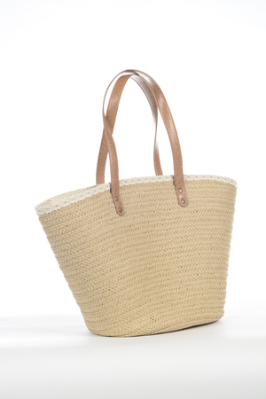 Wicker beach bag on white background Stock Photo - 105234277