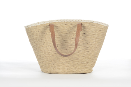 Wicker beach bag on white background