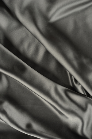 Effects of light in one gray satin fabric